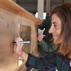 Graceland employees and guests signed the gold beam that was put into place during the Guest House at Graceland