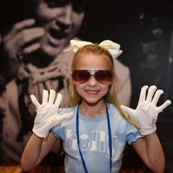 Holly shows off her white archival gloves!