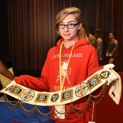 The Archives Team allowed campers, like Echo, to hold Elvis artifacts - with gloves on, of course.