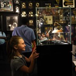 Olivia explores Elvis: The Entertainer Career Museum.
