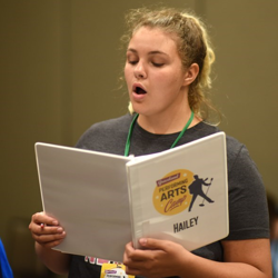 Hailey practices songs during the music workshop.