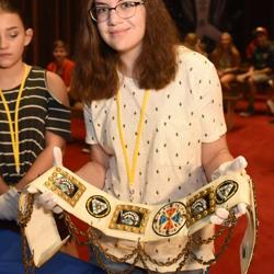 Addie holds an Elvis belt!