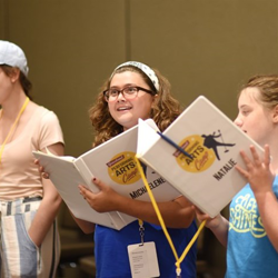 Michaelene and the yellow group practices their songs during a workshop.
