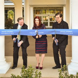 Graceland CEO Jack Soden, Priscilla Presley and Joel Weinshanker, Joel Weinshanker, Managing Partner, Graceland Holdings, LLC, cut a blue ribbon to officially open The Guest House at Graceland at one of the ribbon cutting ceremonies.