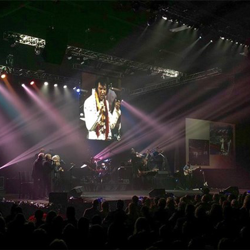 An all-star band and back-up singers performed live with Elvis on the big screen during the Holiday Concert Weekend.