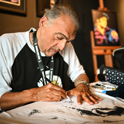 Artist Joe Petruccio created works of art in between meeting fans at Elvis Week.