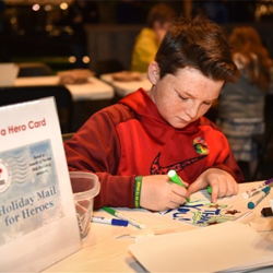 Scouts got crafty in the Elvis Presley Automobile Museum. They created cards for the troops, as well as picture frames.