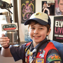 Scouts learned about being a DJ at the Sirius XM Elvis Radio booth.