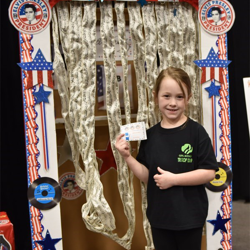 Scouts learned about the voting process as they voted for their favorite Elvis song.