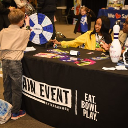 Scouts had fun at the Main Event Entertainment table.