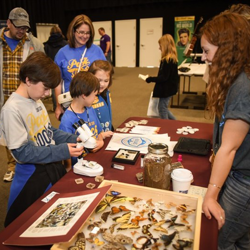 Scouts met with vendors and organizations to learn about everything from Elvis to animals to robotics and more.