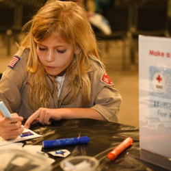 This Girl Scout made cards to send to the troops.