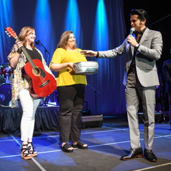 Tupelo Hardware gives away a guitar to a lucky fan at the Semifinal Round in Memphis.