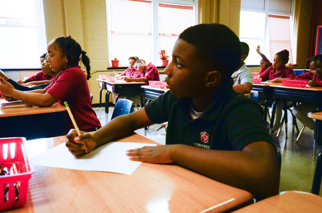students at Cornerstone Prep Lester at their desks in the classroom