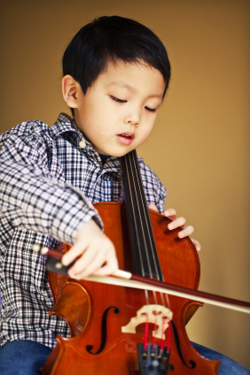 Student playing small size cello