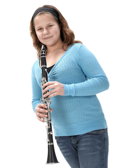 student holding a rental clarinet