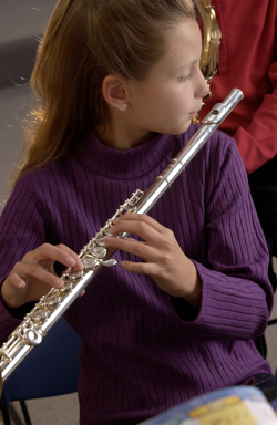 Student playing flute in school band