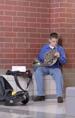Student playing French horn