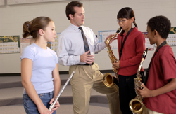 Beginning band students with band director