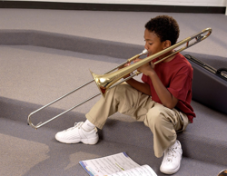 Student playing beginner trombone