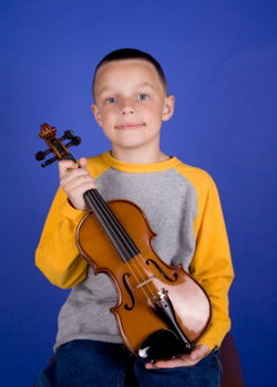 Boy holding violin