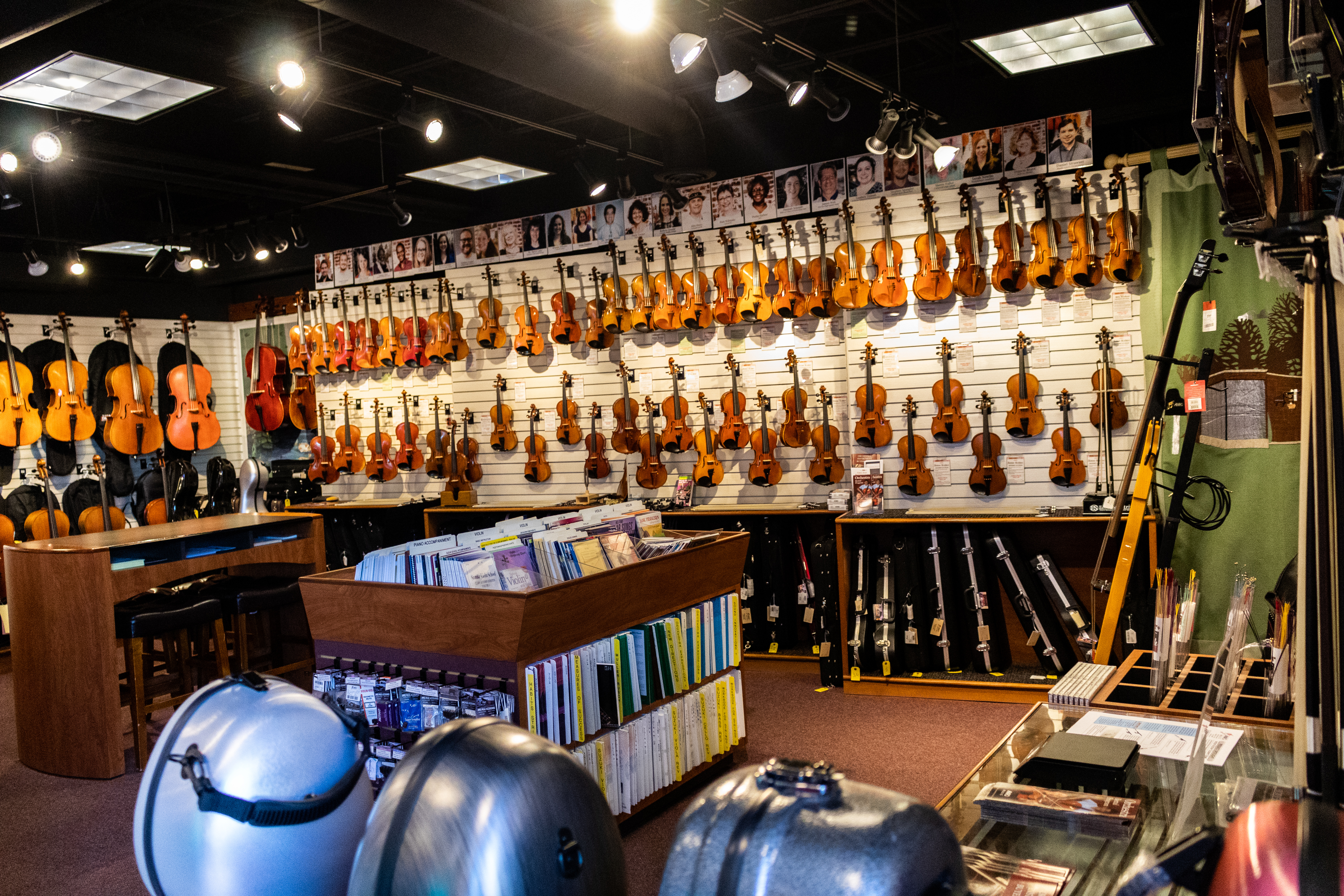 Violins, violas, cellos, sheet music, and string accessories can be seen from the front entrance of Amro Music Store