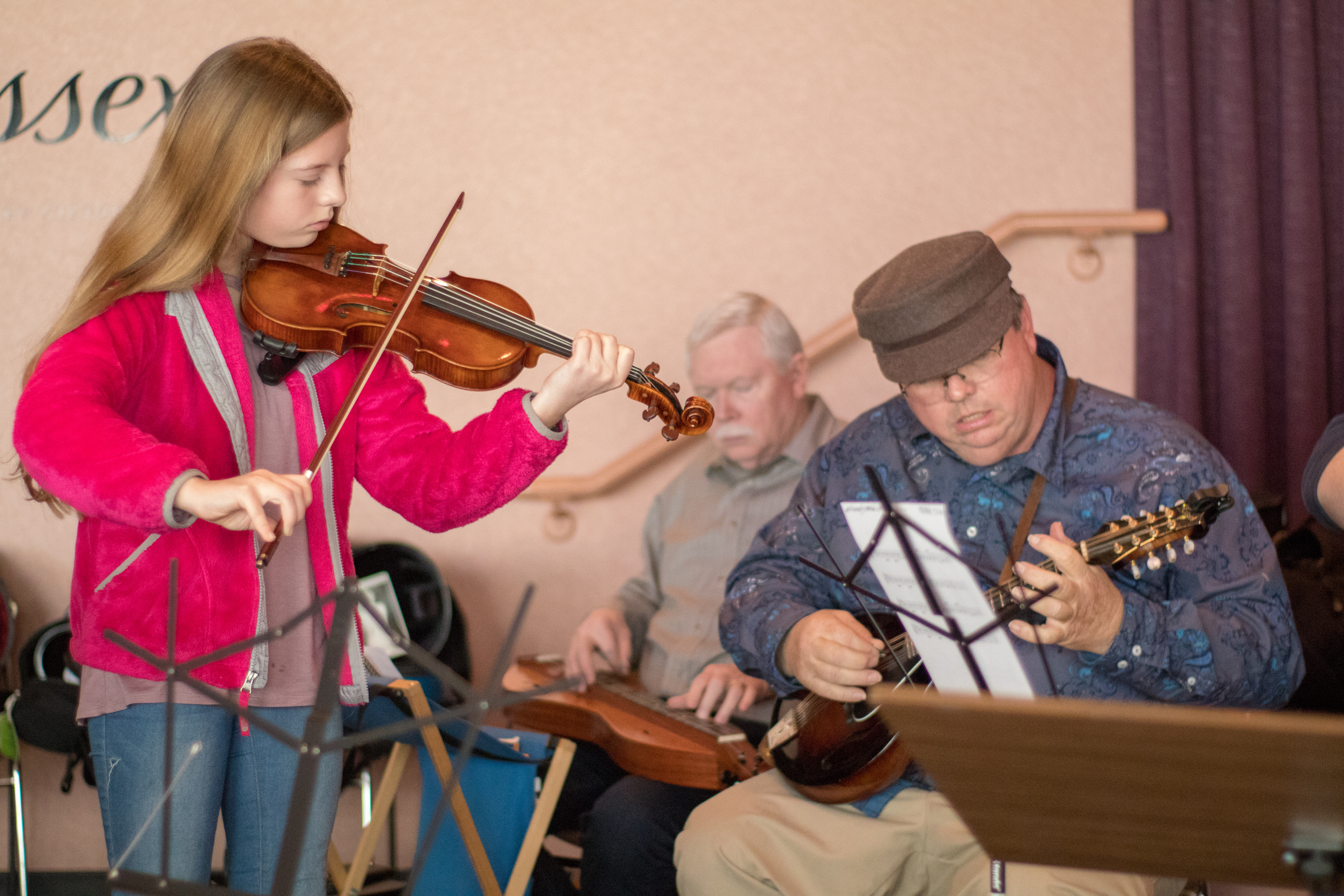 A young violinist plays along with the backing band at our Fiddle Fair.
