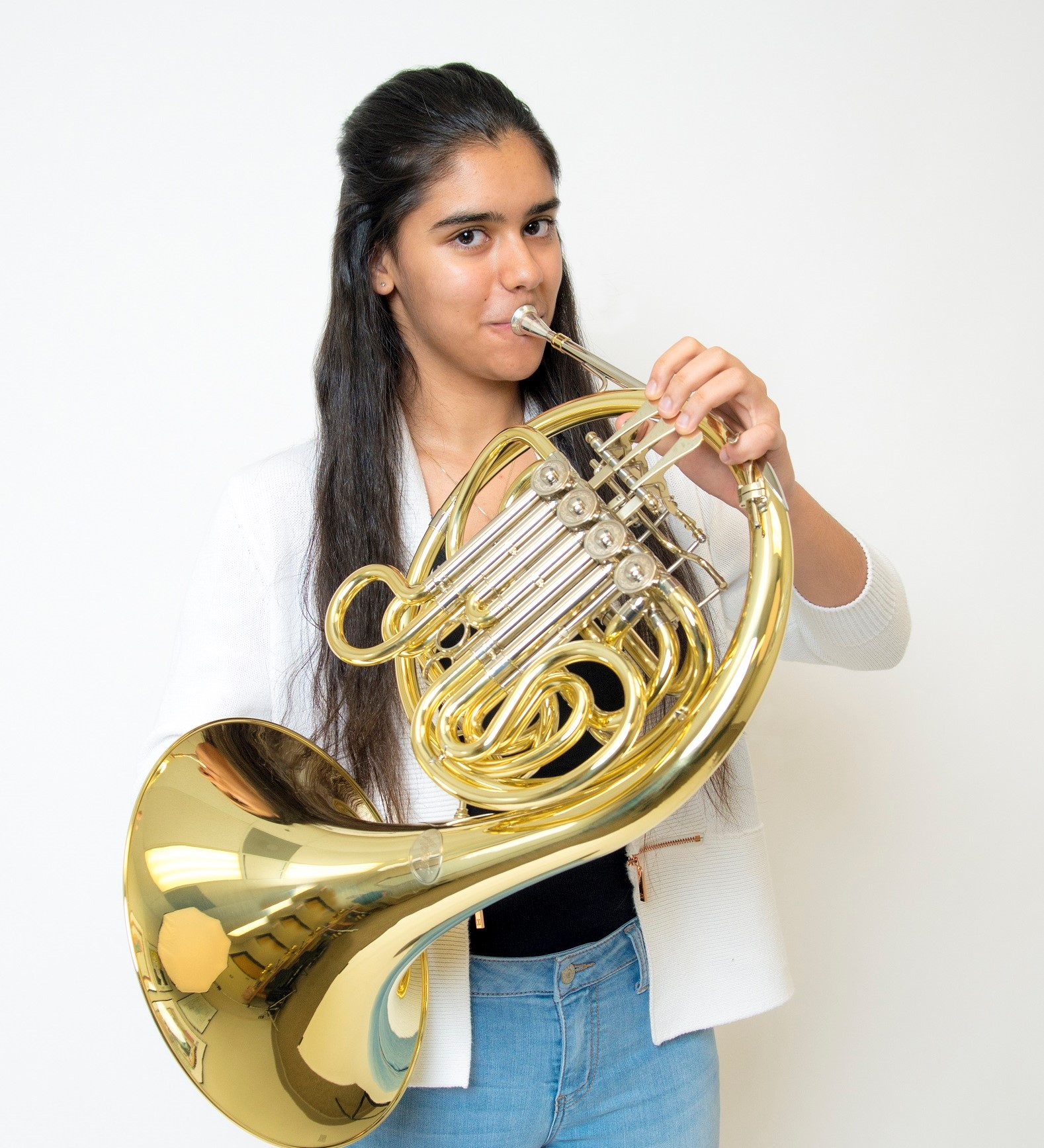 Student Playing the French Horn