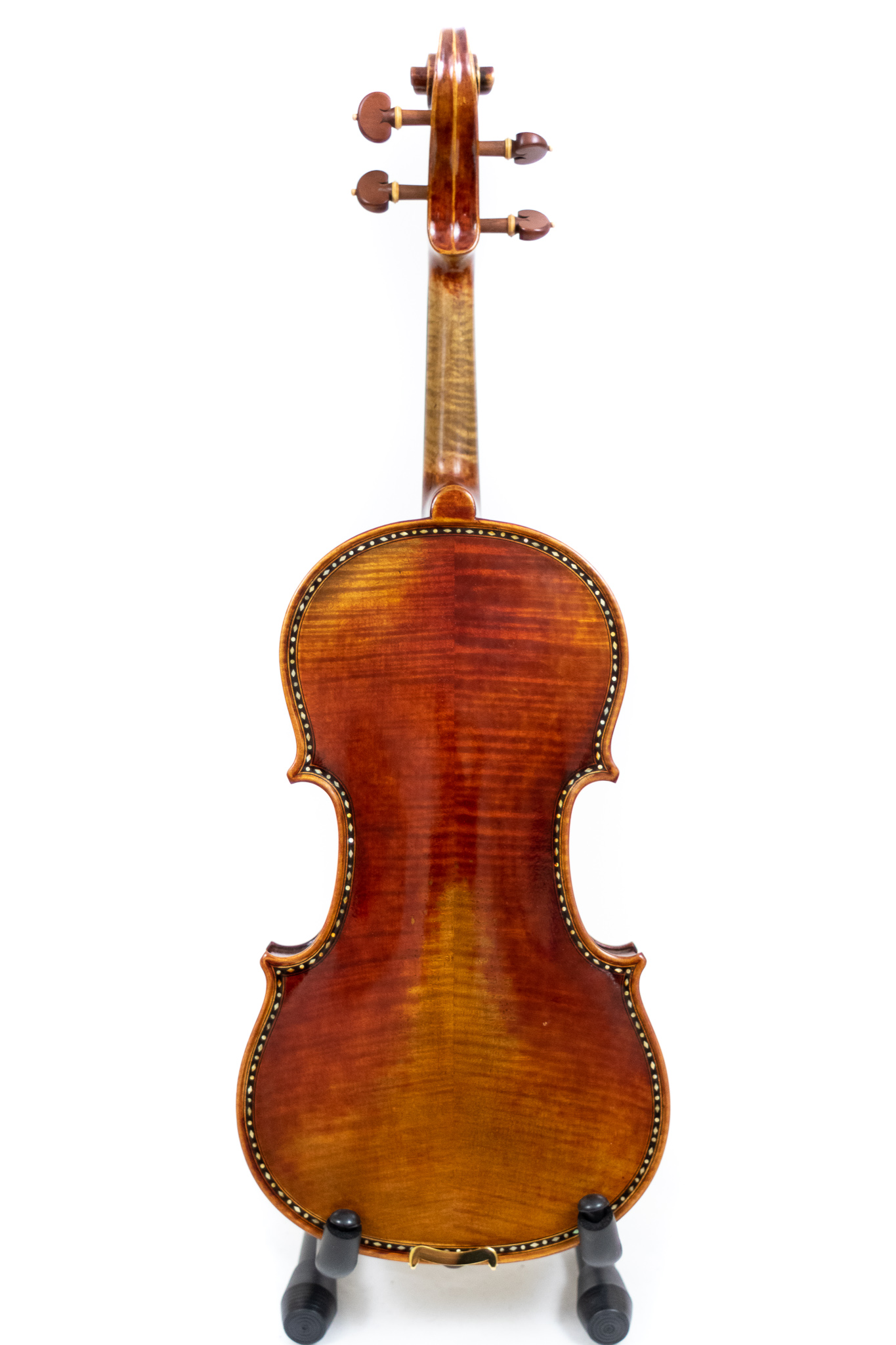 The back view of a finely crafted and ornamented master line violin