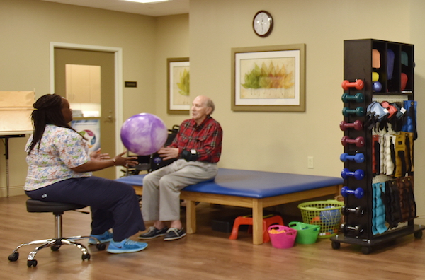 Older man in physical therapy session