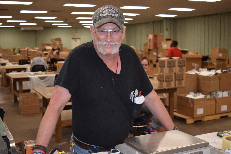 Worker at Baddour Custom Packaging