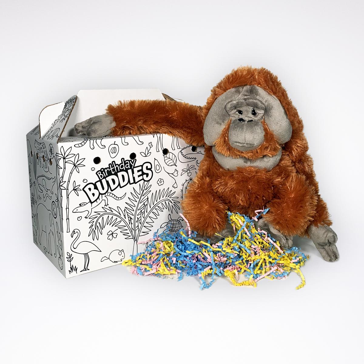 photo of stuffed orangutan next to a special birthday buddies adoption box