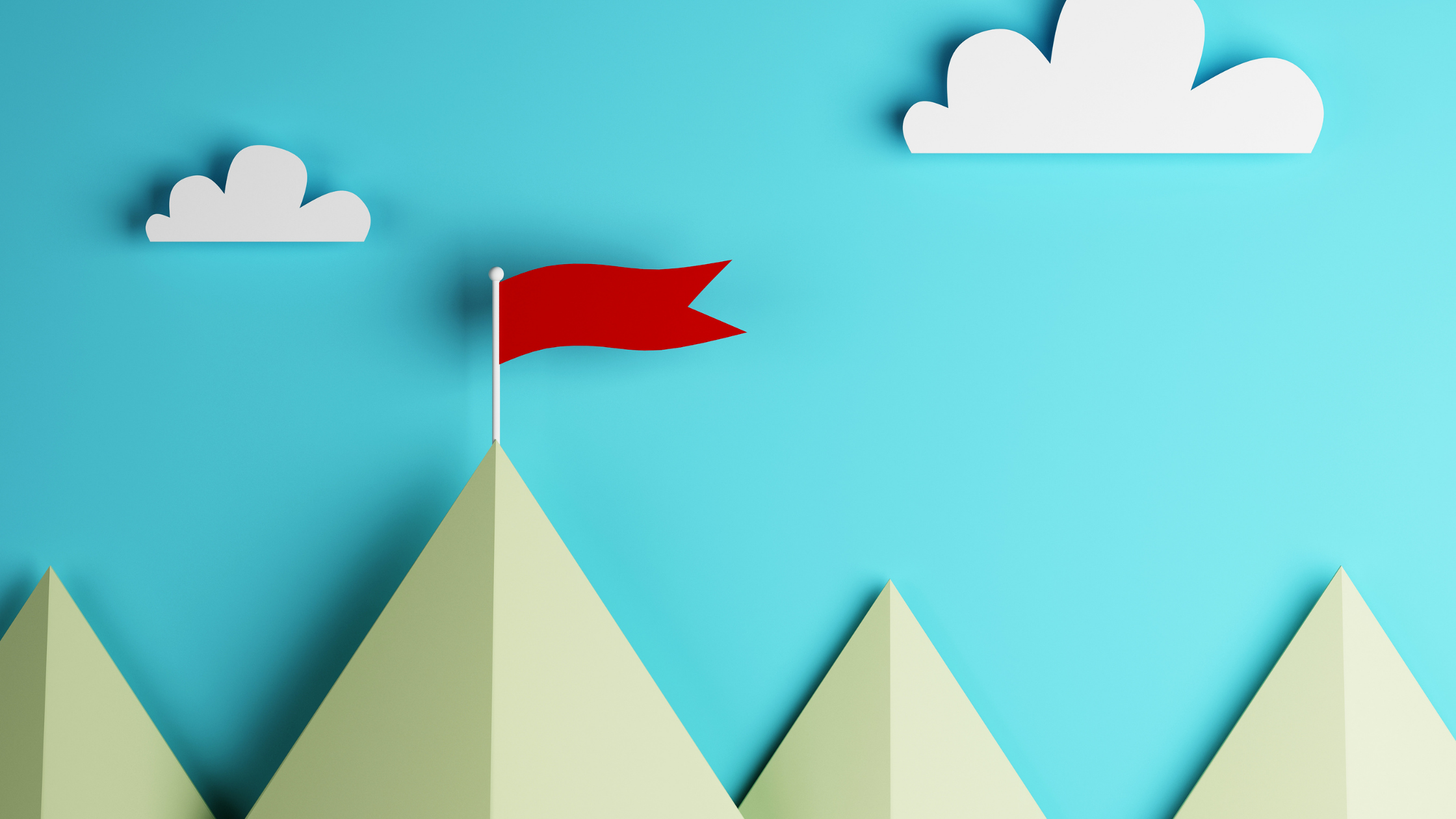 craft paper cutout of mountains, sky, and a red flag