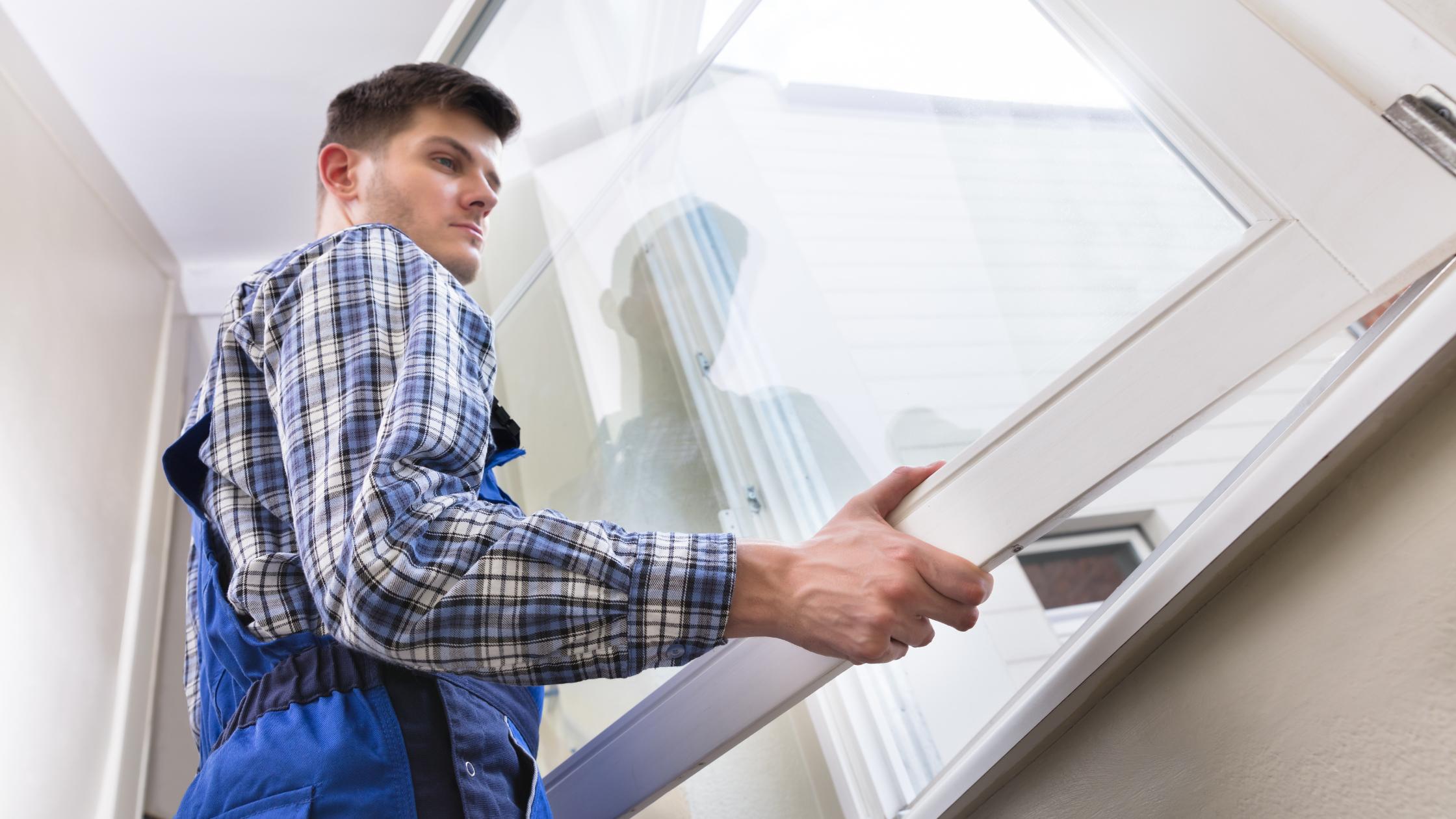worker installing a window