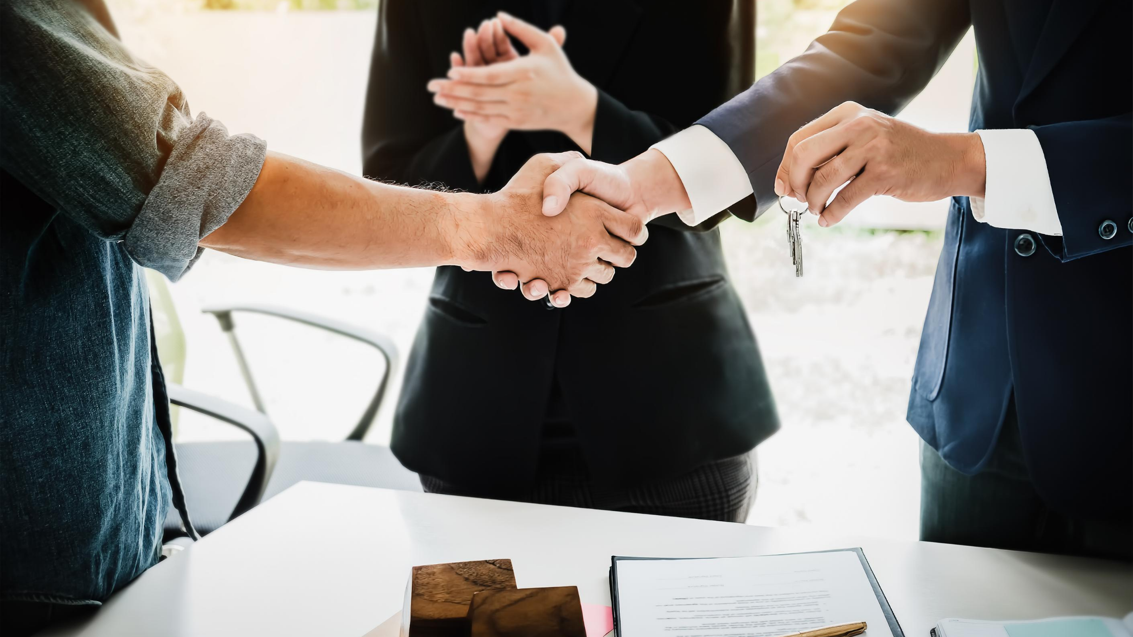 shaking hands with a realtor