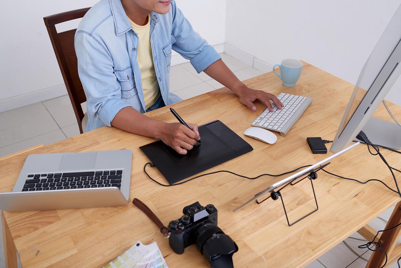photographer at a desk