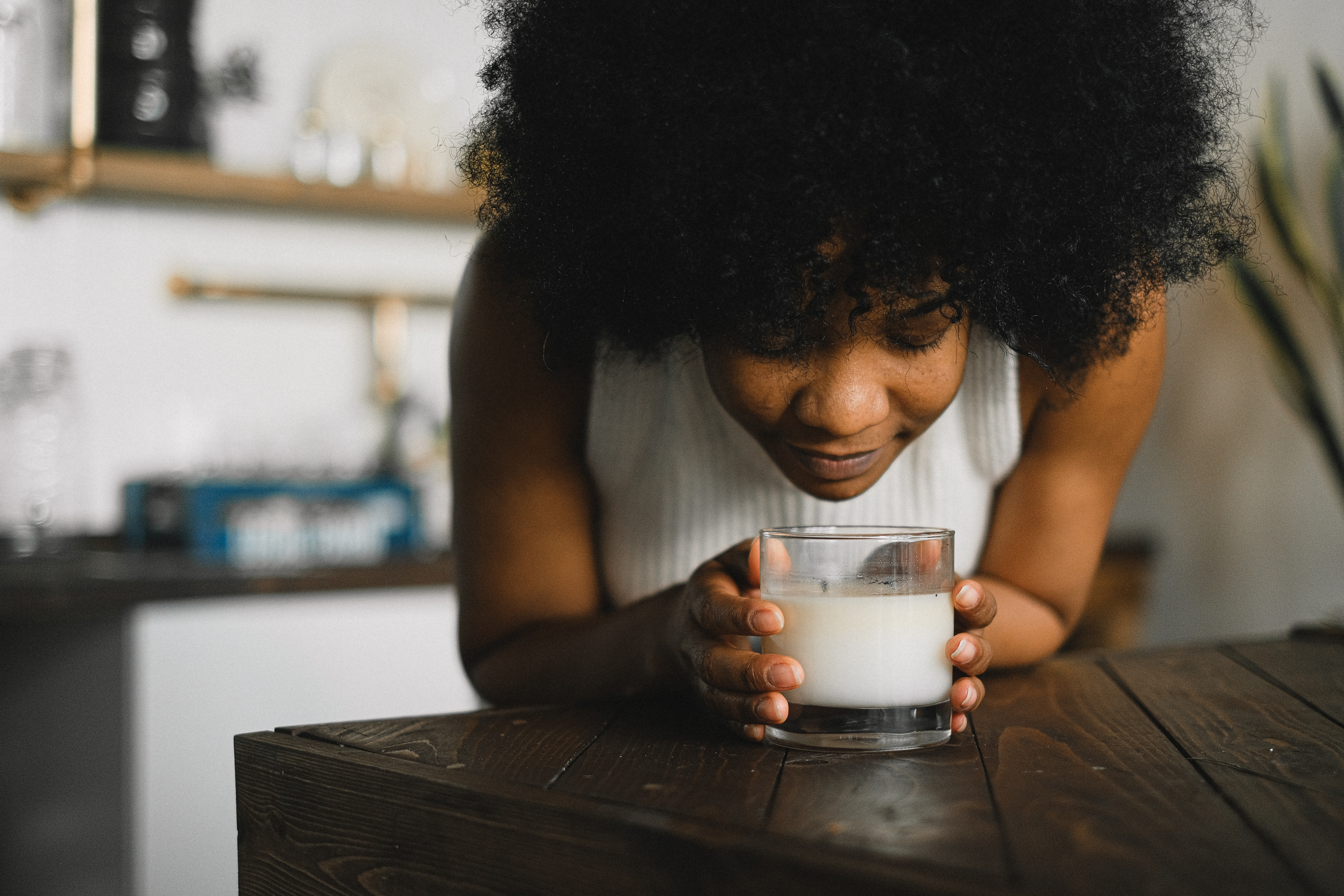 woman sniffing candle
