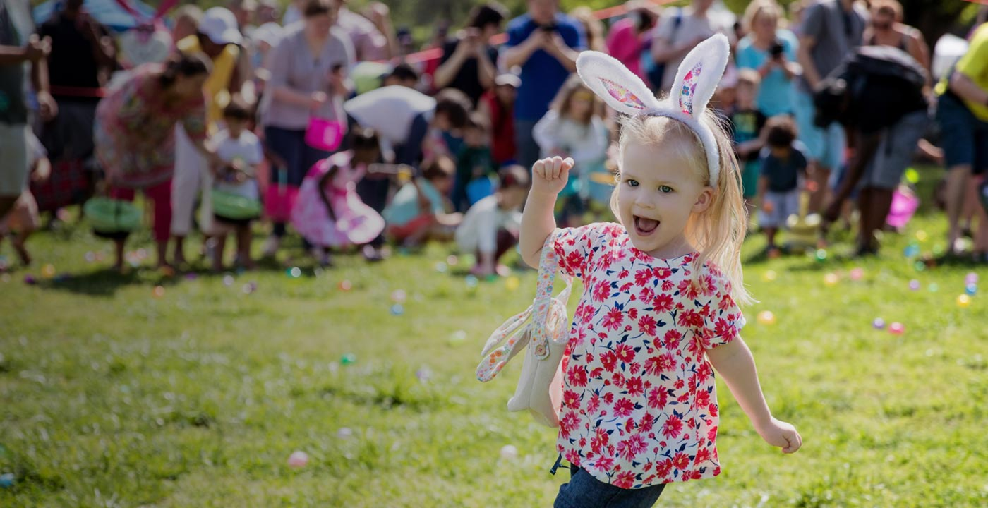 Child running during an Easter egg hunt