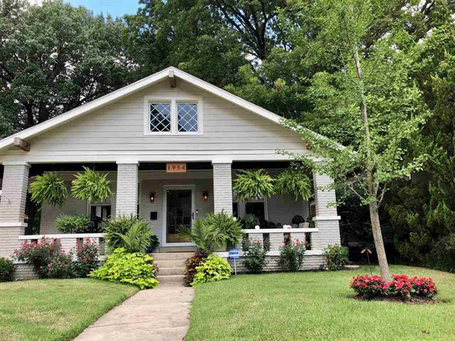 gray brick house with front porch