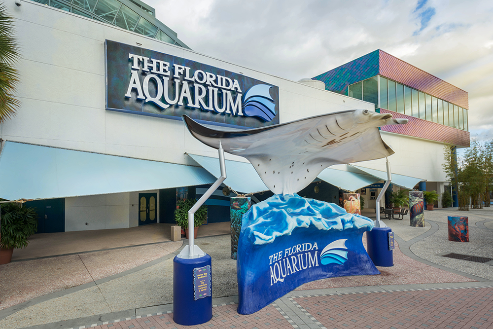 The Florida Aquarium exterior building view on a partly cloudy Florida day