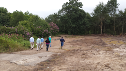 Members of the A&B Construction Company and Alta Planning + Design team walk the Phase 9: Epping Way project site. Work has begun on the first new phase of the Greenway, with a focus on initial clearing and rough grading of the project site.