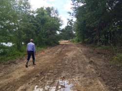 Bob Wenner of the Wolf River Conservancy walks a portion of the trail corridor under construction at Epping Way. The trail is scheduled to be open for public use in the Spring 2017.