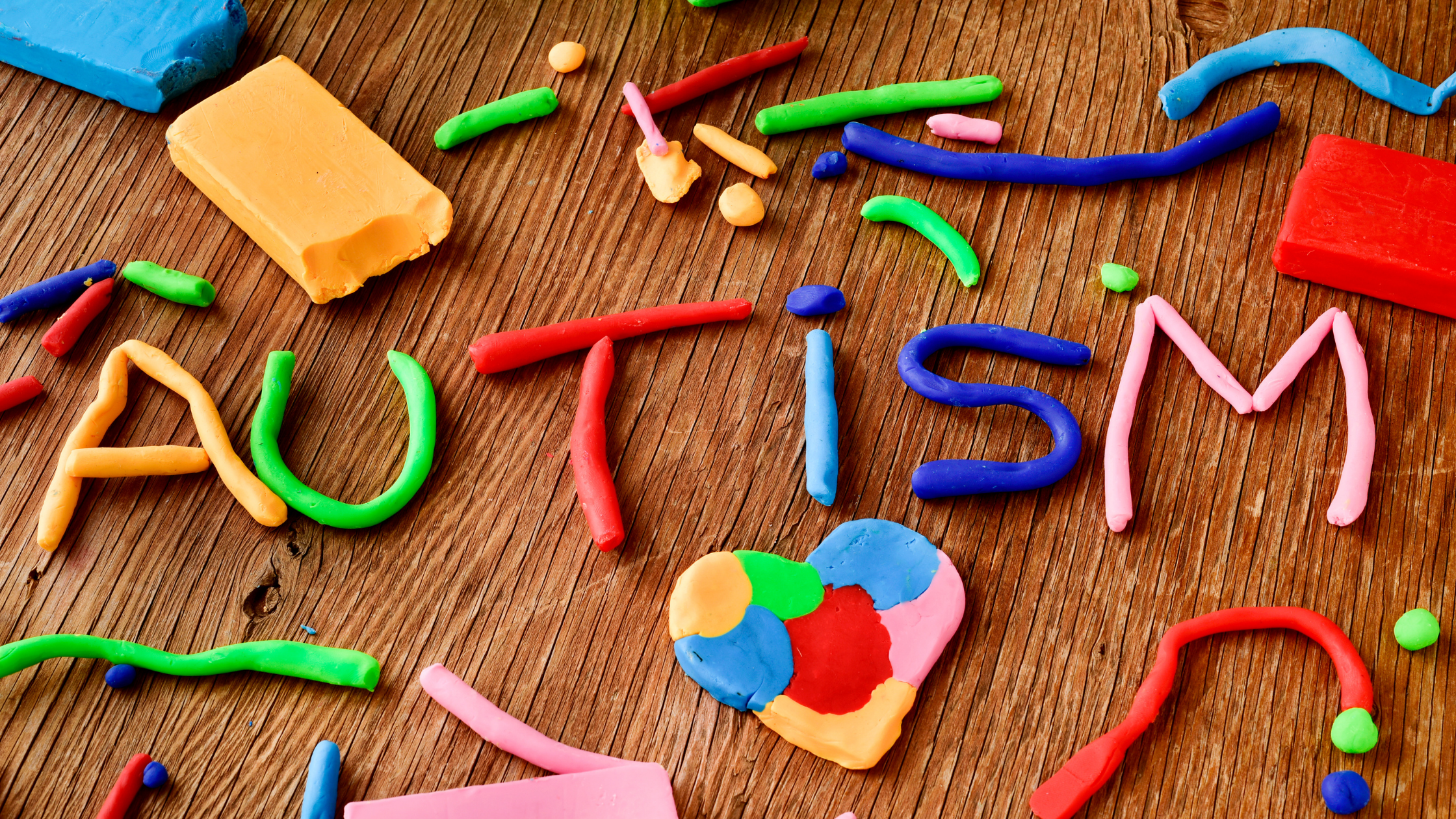autism spelled in colorful clay