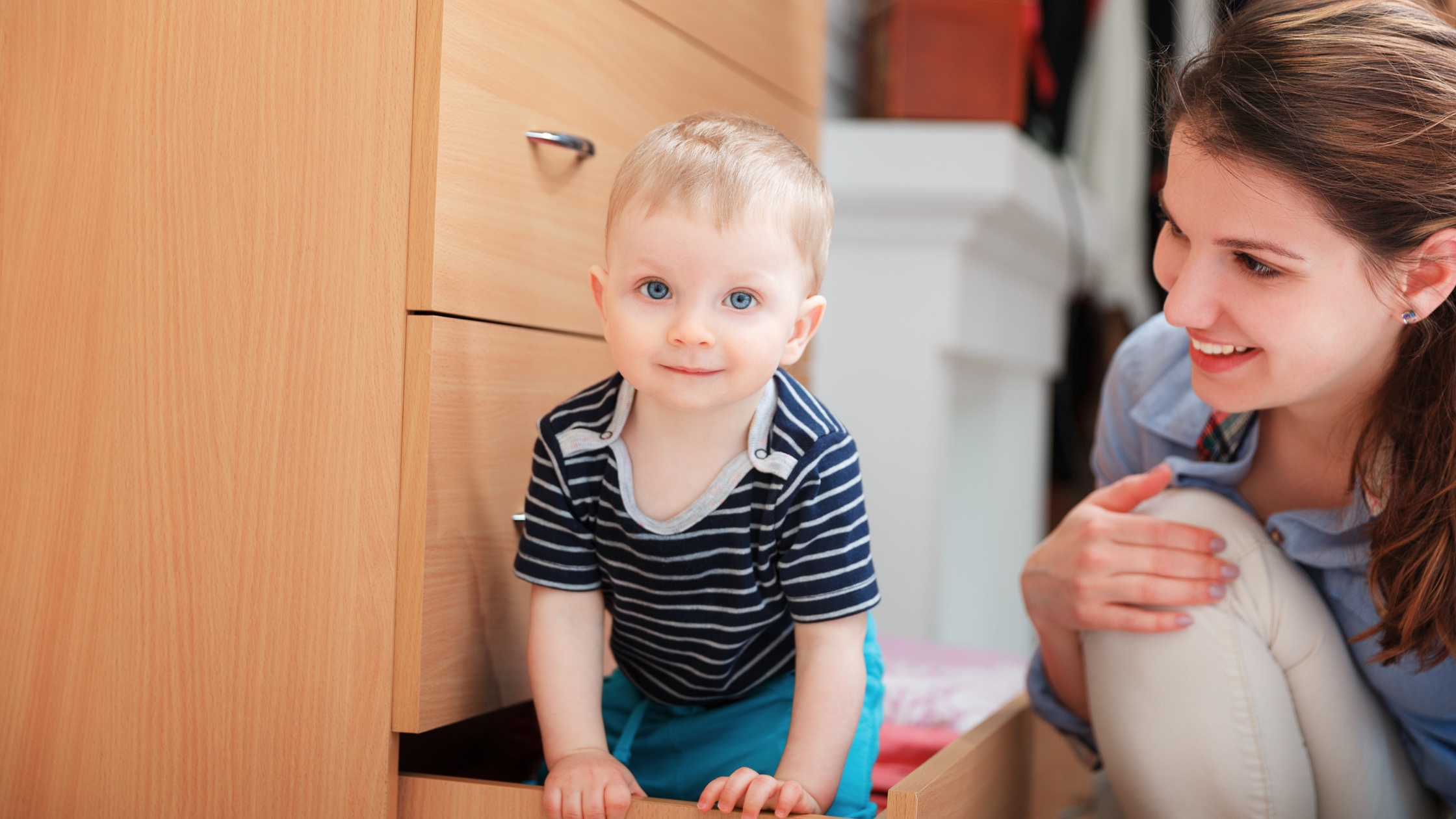 baby in a dresser drawer attended by mother