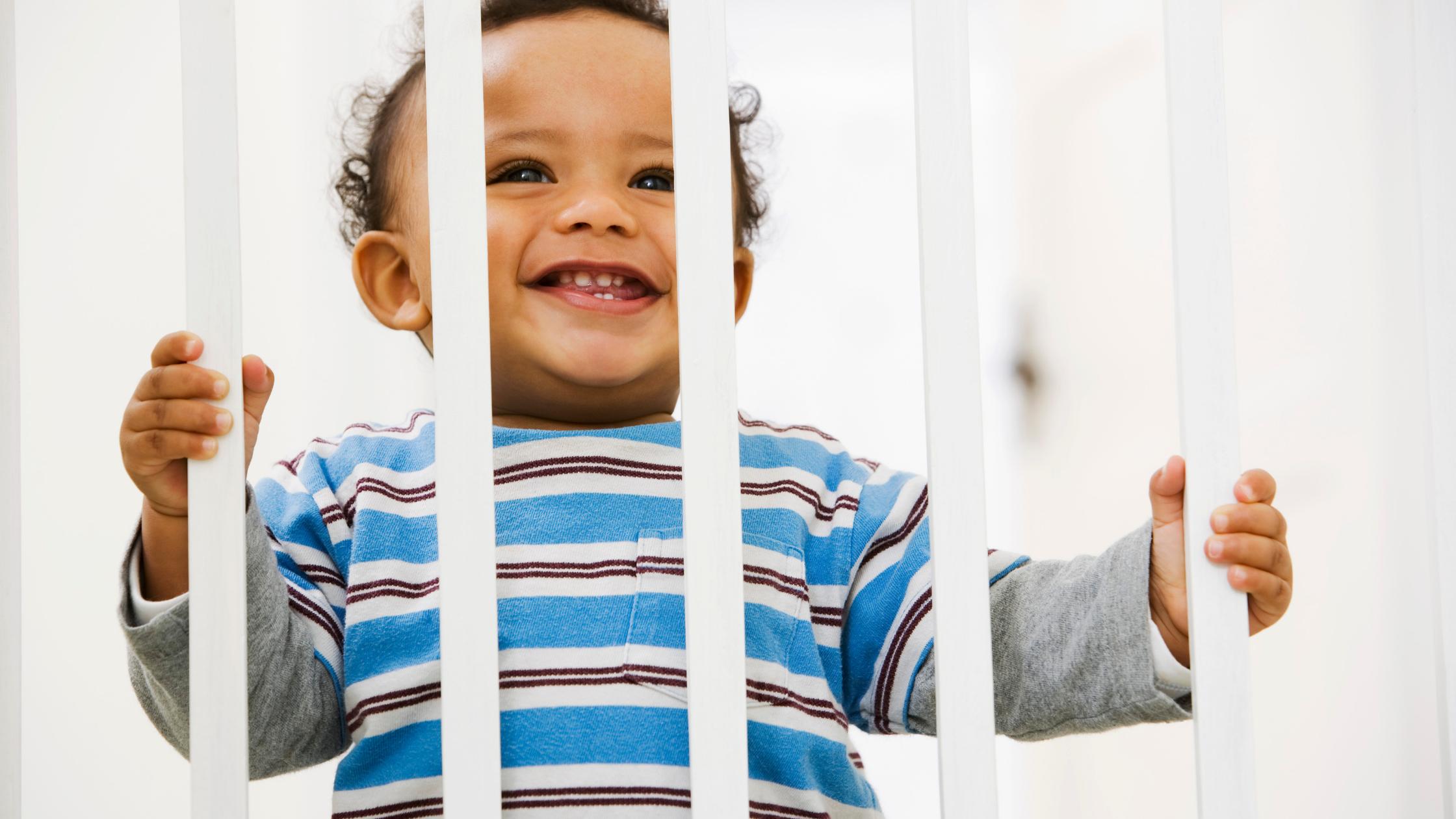 baby behind a gate