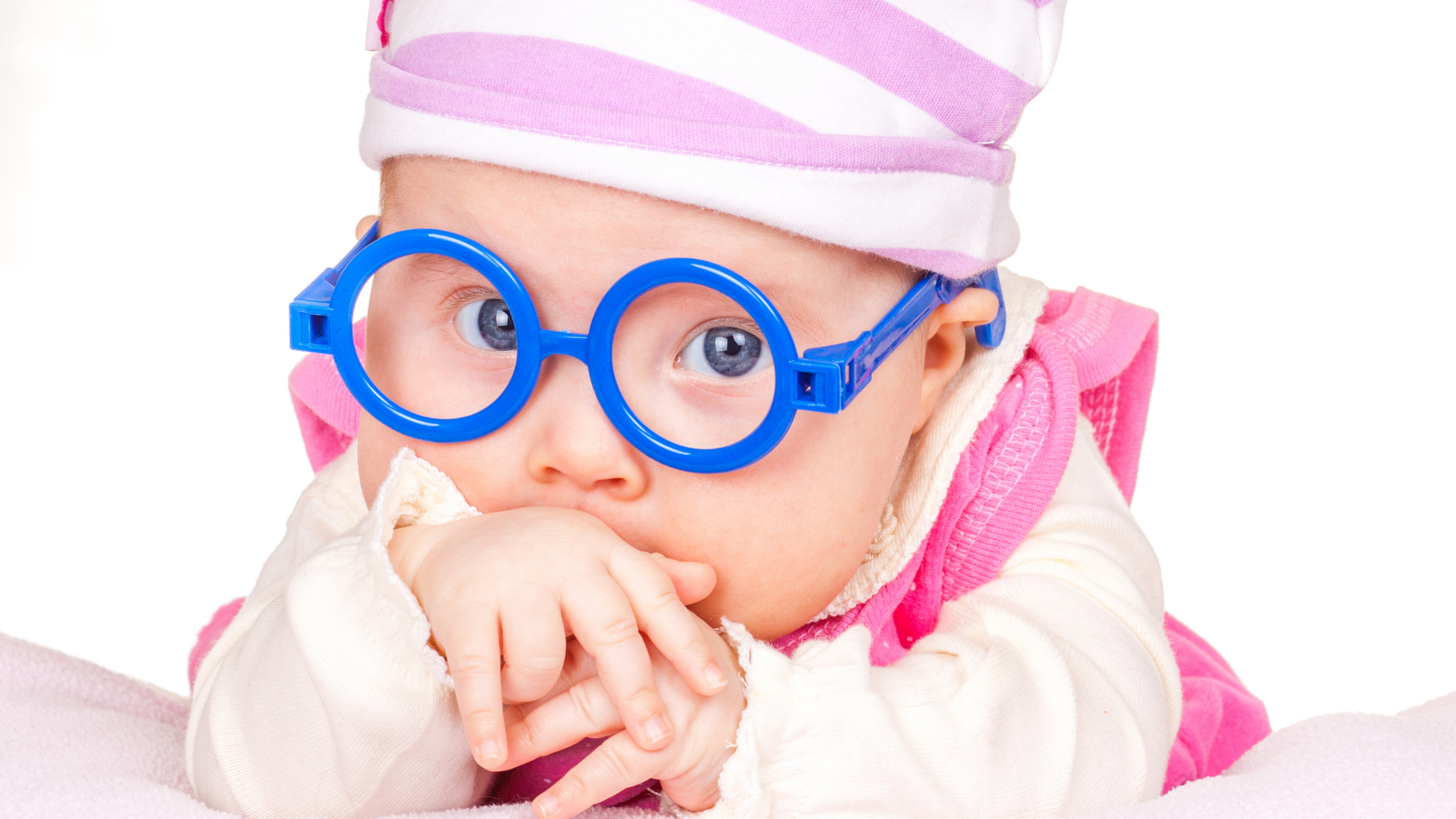 baby wearing blue glasses and a pink outfit