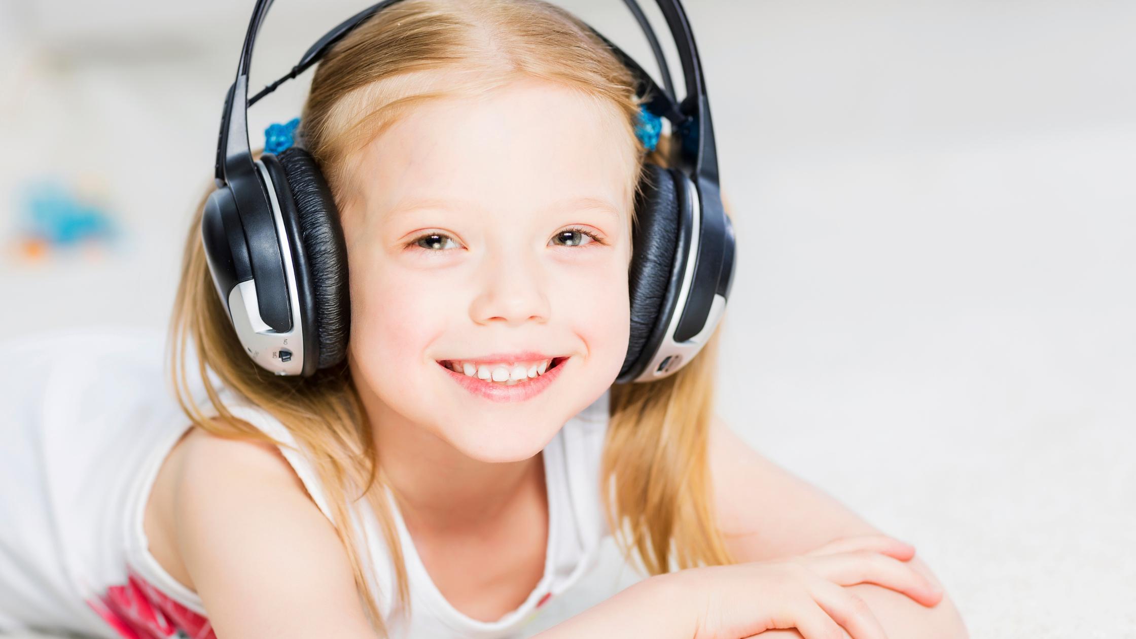 child with headphones on
