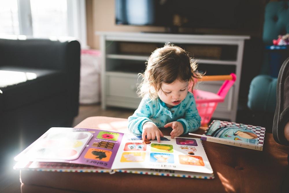 Little girl looking at a picture book