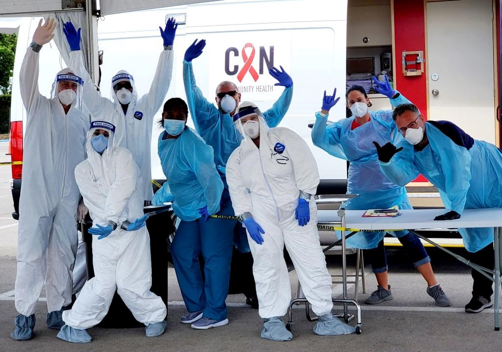 healthcare workers wearing covid-19 protection suits