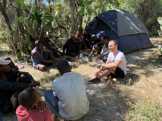 Josh Lucas with local members of community camping in Madagascar